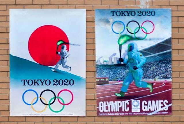 韓国の「サイバー外交使節団」VANK(バンク)が東京五輪を防護服聖火ランナーで揶揄するポスターを日本大使館の敷地の壁に貼った!今後、これらポスターを世界中に配布するという!